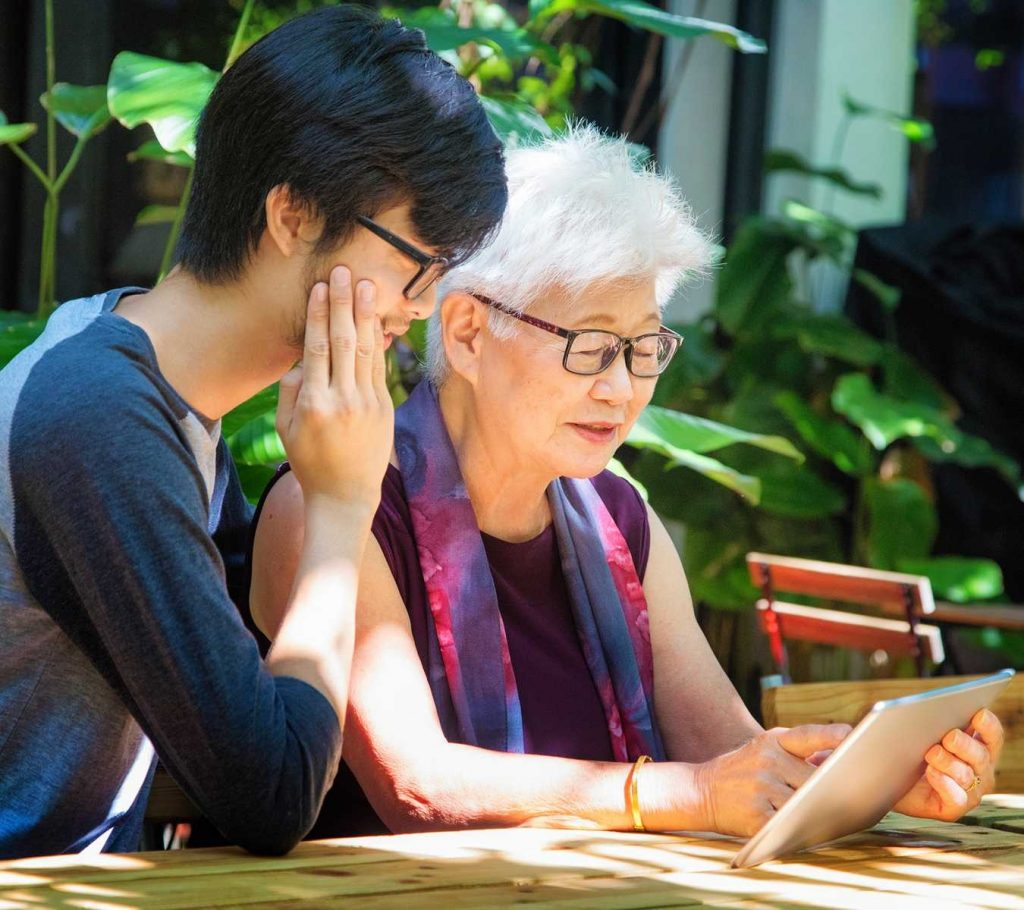 Asians with tablet